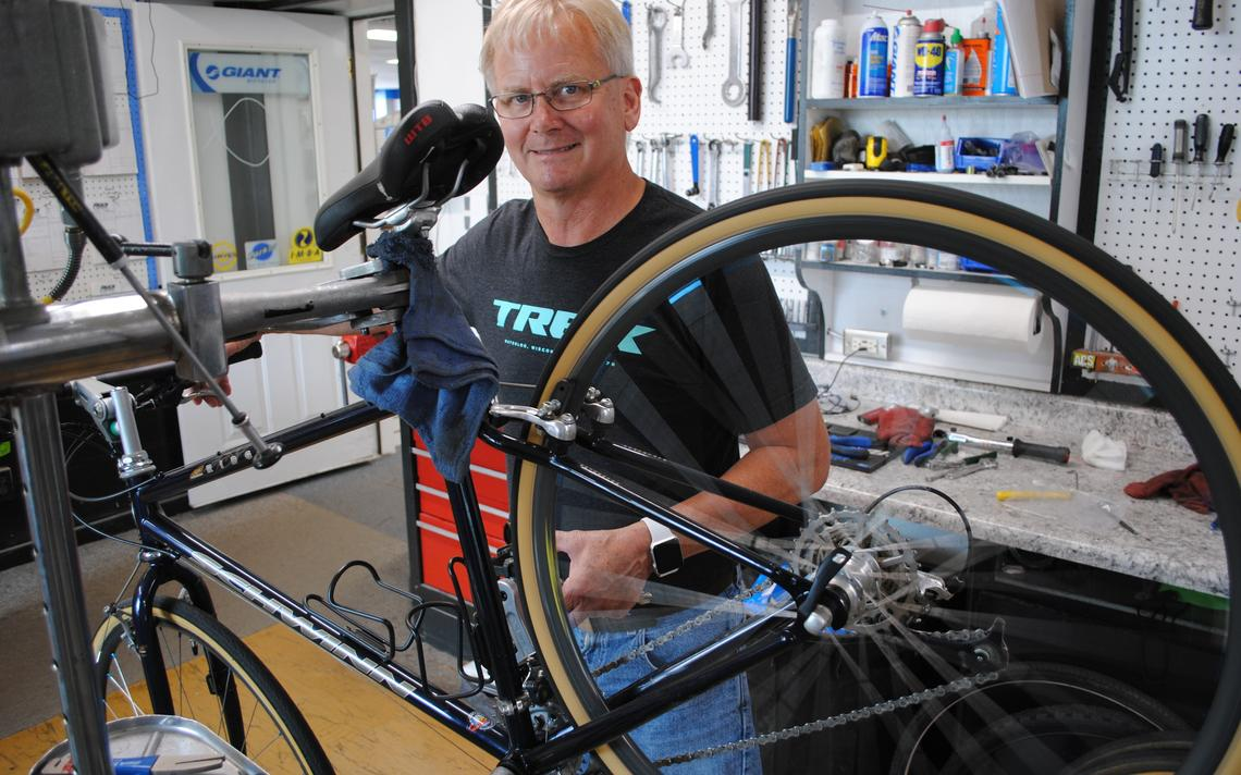 "Rick Norsten, of Rick's Cycle and Sports in Willmar, is shown at his shop in downtown Willmar. Norsten has never seen as much demand for bicycles and service as this year. ""We can't keep up with it,"" he said.  Tom Cherveny/West Central Tribune"