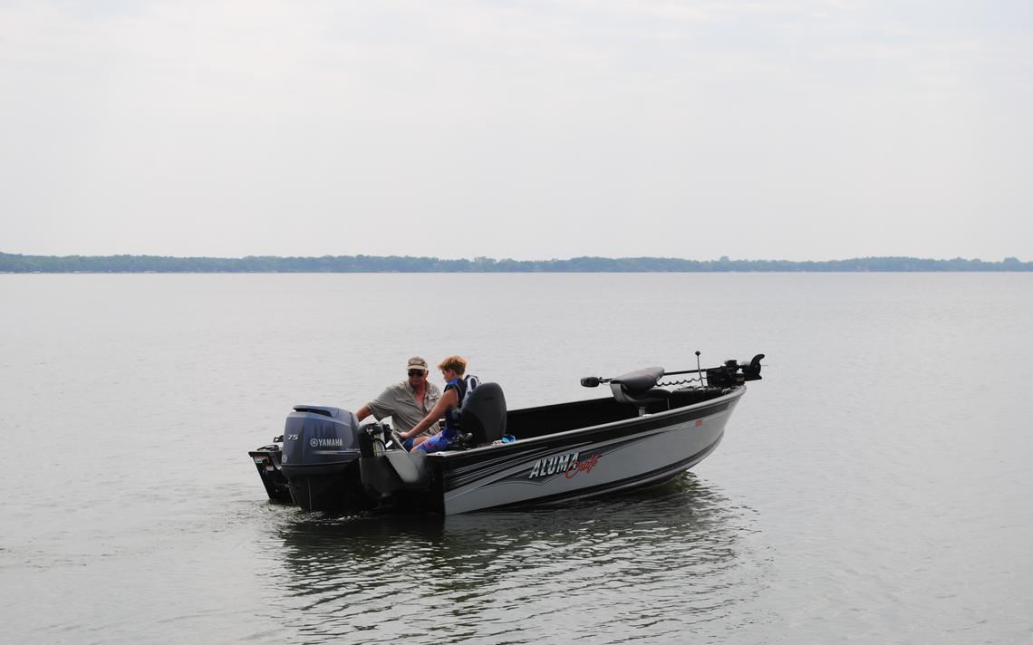 A grandfather and his grandson head out on the quiet waters of Green Lake in August. Outdoor activities of all types saw big increases in the past year.  Tom Cherveny/West Central Tribune