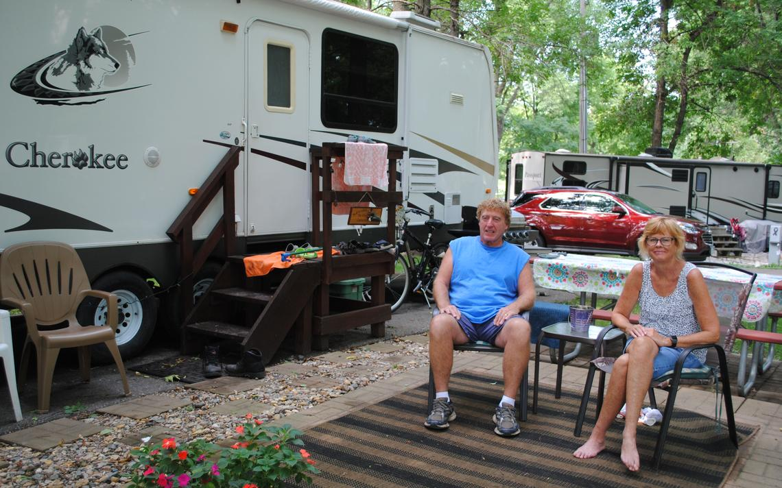 Campground hosts Jeff and Anne Heerdt enjoy a quiet summer day at Kandiyohi County's popular park on the north shore of Green Lake. Despite a late start caused by COVID-19 restrictions, state, county and municipal parks saw big increases in usage during the past year.  Tom Cherveny/West Central Tribune