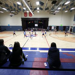 Parents watch a youth basketball game at Providence Hall Junior High in Herriman on Saturday, Dec. 19, 2020.