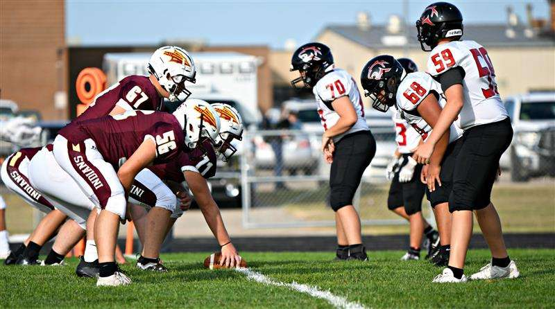 """HHS JV football plays at the HHS practice field. The varsity plays at the Fort Hays State University stadium. One of the wishes for the HHS athletic program is its own all-weather turf field. Photos courtesy of Kim Reel Photography&nbsp;<a href=""""https://www.facebook.com/kimreelphotography"""" target=""""_blank"""">https://www.facebook.com/kimreelphotography</a>"""