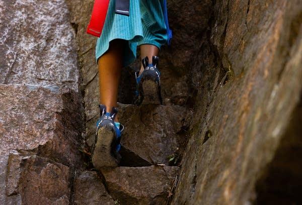 Feet descend down rocks.