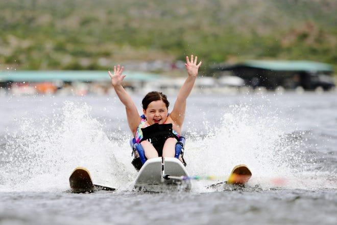 Bella Collett water skis at the Arizona Adaptive Water Sports Kids Day, Oct. 9, 2021, Bartlett Lake in Carefree, Arizona.