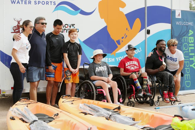 Paralympian Matt Scott surprises four youth athletes with adaptive kayaks purchased with a grant awarded from The Hartford at the Arizona Adaptive Water Sports Kids Day, Oct. 9, 2021, Bartlett Lake in Carefree, Arizona.